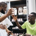 Reactions as suspended Man City player chilling with high famous fraudster Hushpuppi