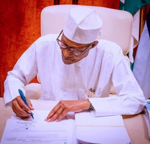 President Buhari signs Petroleum Industry bill into law after 21 years